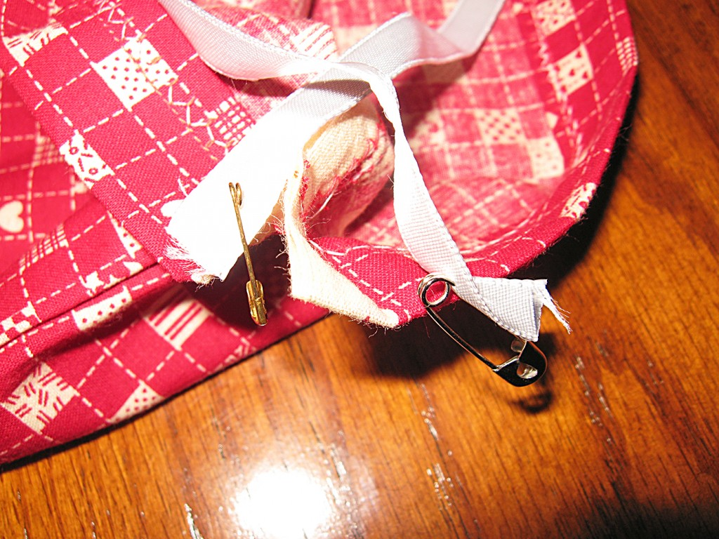 11 Attach safety pins to casing and to one end of cord