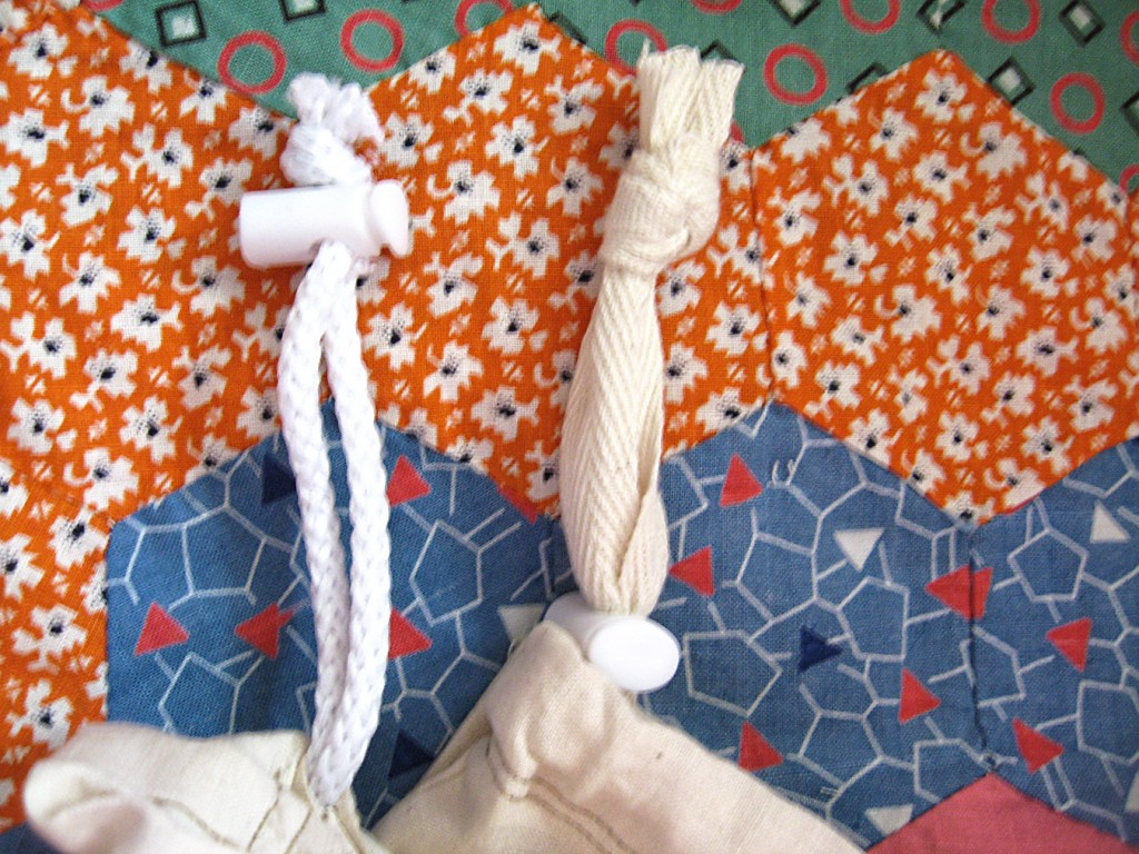 13 Toggles hold the drawstring closed